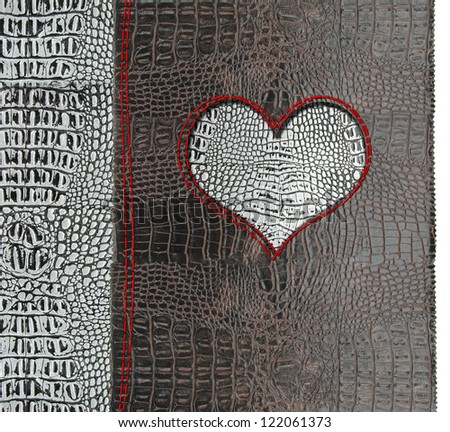 Heart shape on leather background - stock photo