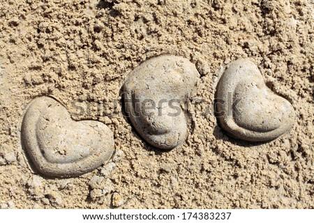 Heart shape on sand - stock photo