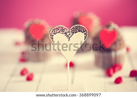 Heart Shape Ornament With Delicious Valentine's Day Cupcakes Behind - stock photo