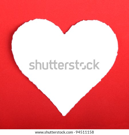 Heart shape symbol over red paper - stock photo