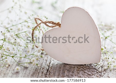 heart shape with copy space and white flowers  - stock photo