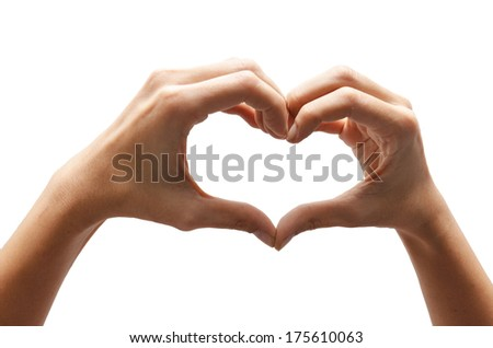Heart shape woman hand making on white background - stock photo