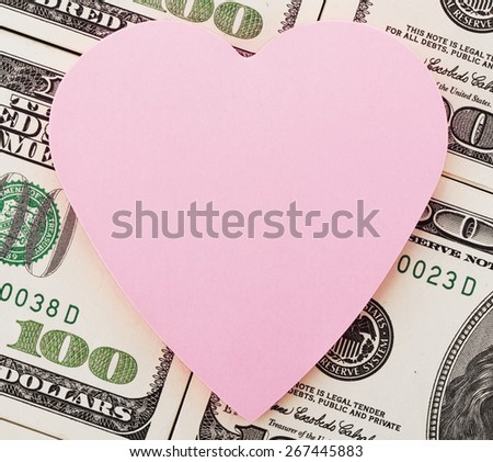 Heart shaped adhesive note on us dollars - stock photo