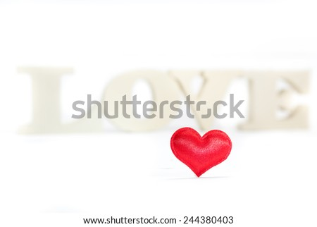 Heart shaped and in the background wooden letters forming word love. Valentines Day background. Shallow depth of field - stock photo