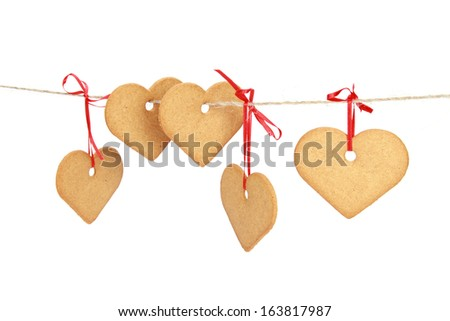 Heart shaped biscuit hanging on rope - stock photo