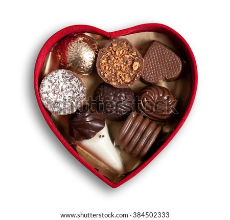 Heart shaped box  with chocolates, isolated, clipping path excludes the shadow. - stock photo