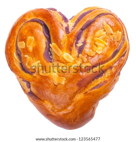 heart shaped bread with love on white background  (clipped path) - stock photo