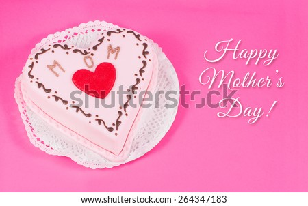 Heart shaped cake for mother's day with text - stock photo