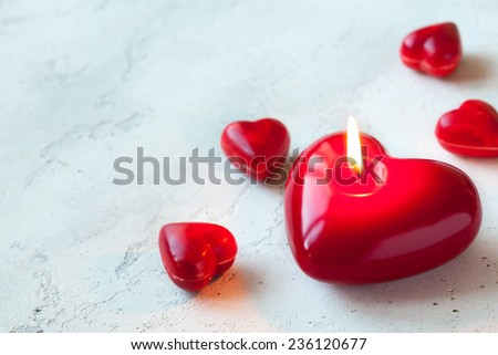 Heart shaped candle and sweet candy for Valentine's day - stock photo