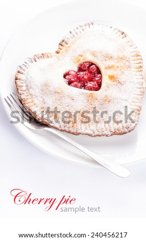 Heart shaped cherry pie with sample text on white background - stock photo