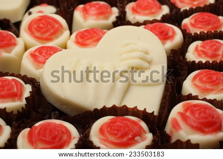 Heart-shaped chocolate background - stock photo