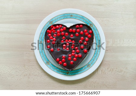 Heart shaped chocolate cake in a plate. Valentine's day and love concept - stock photo