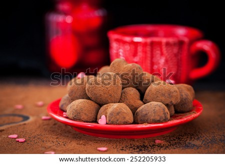 Heart shaped chocolate truffles on red plate, Valentine concept - stock photo
