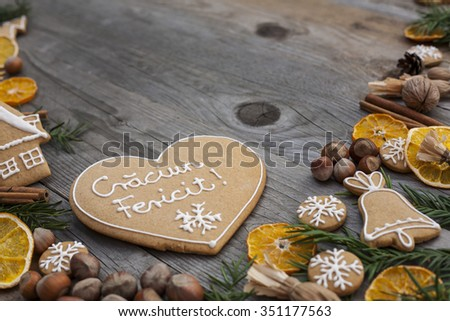 Heart shaped Christmas gingerbread written in Romanian - stock photo
