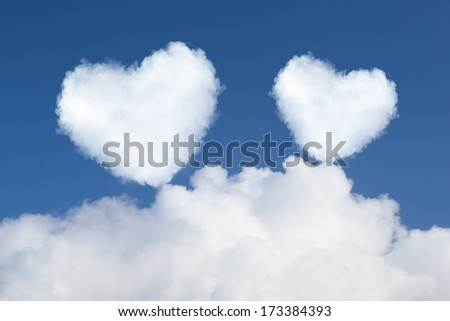 heart shaped clouds in the sky - stock photo