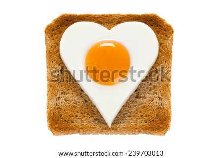 heart shaped cooked egg on toast - stock photo