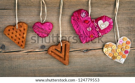 Heart shaped cookie and red handmade heart - stock photo