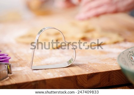 Heart shaped cookie cutter - shallow depth of field - stock photo