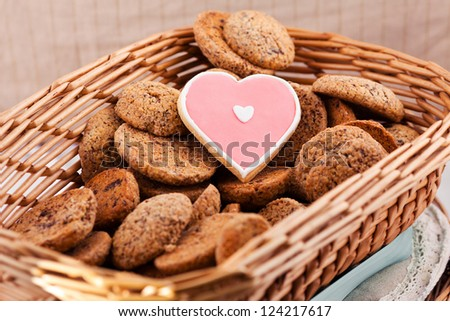 Heart shaped cookie for valentines day into basket - stock photo