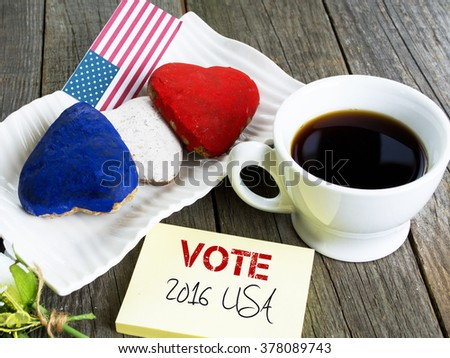 Heart shaped cookies color red, blue, white. Cup of coffee (tea), USA flag, decoration on old wooden table. Patriotic Breakfast Concept - 2016 USA presidential election VOTE - stock photo