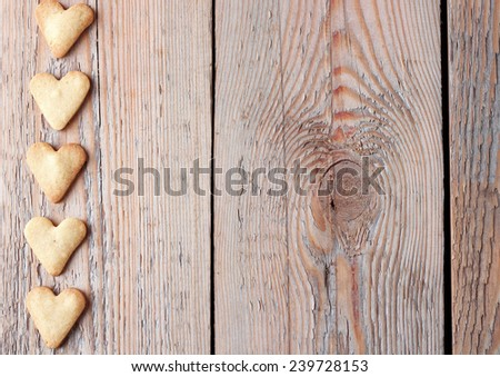 Heart shaped cookies on a wooden table for Valentine's day. Copy space background - stock photo