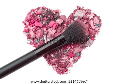 heart shaped crushed eyeshadows with brush - stock photo