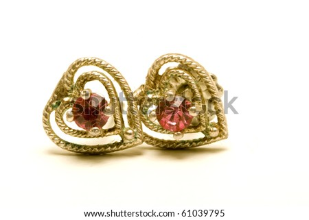 heart-shaped earrings - stock photo