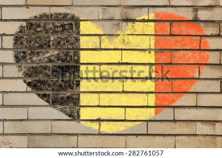 heart shaped flag in colors of Belgium on brick wall - stock photo