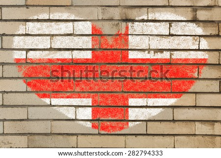 heart shaped flag in colors of england on brick wall - stock photo