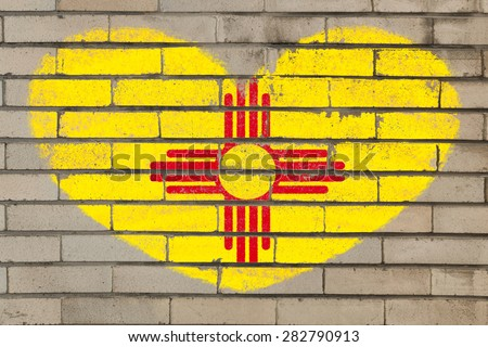 heart shaped flag in colors of new mexico on brick wall - stock photo
