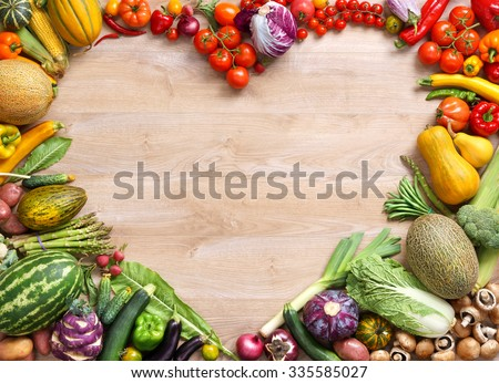 Heart shaped food / food photography of heart made from different fruits and vegetables on wooden table. Copy spacy for your text. High resolution product - stock photo
