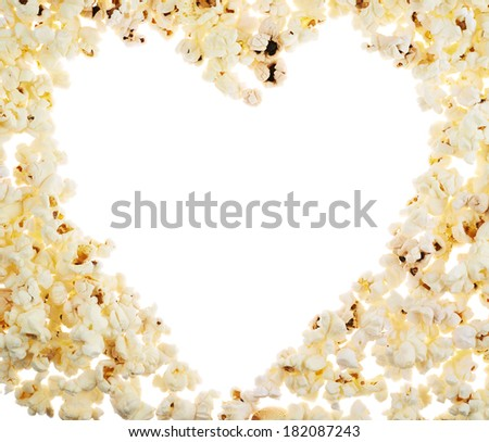 Heart shaped frame made of popcorn over the white background - stock photo