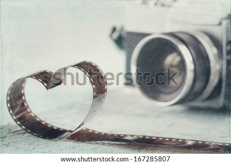 Heart shaped from film negative and old vintage camera - concept for photography - stock photo