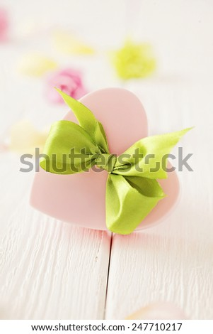 heart shaped gift box with ribbon bow. valentines day - stock photo