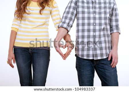 Heart Shaped Hands of Couple in Love - stock photo