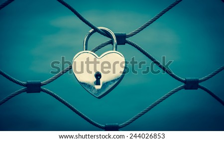 Heart shaped love padlock in Paris. Valentine's day background. Toned photo. - stock photo