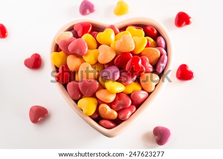 Heart shaped multi-colored Valentines Day candies in a ceramic bowl - stock photo