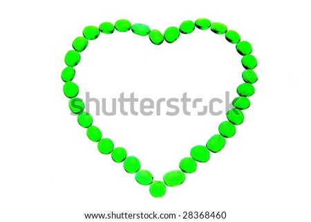 heart-shaped pattern made from green vitreous ball - stock photo