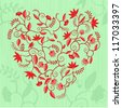 Heart shaped pattern with flowers, leaves and curles - stock photo