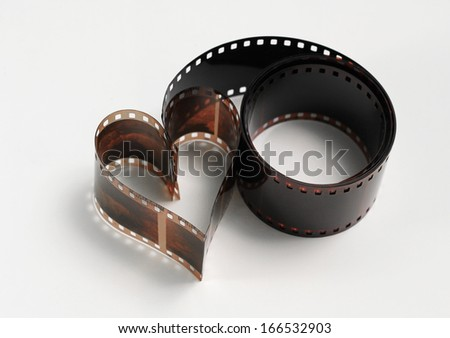 Heart shaped photo film, concept of passion for photography - stock photo