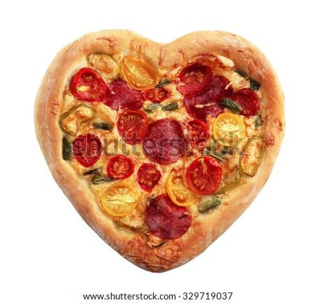 Heart shaped pizza isolated on white - stock photo