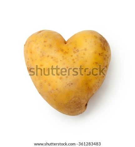 Heart Shaped Potato Isolated on a White Background. - stock photo
