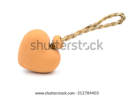 Heart-shaped pottery bells on white background. - stock photo