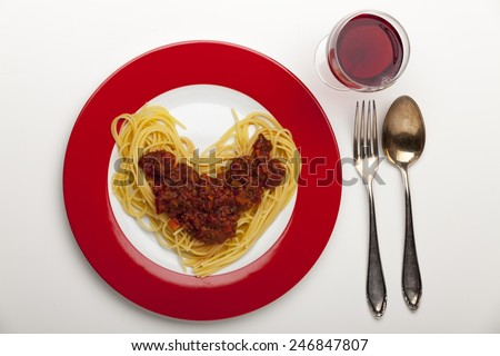 heart shaped spaghetti on a plate  - stock photo