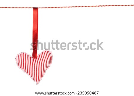 Heart shaped toy hanging. Isolated on white background - stock photo