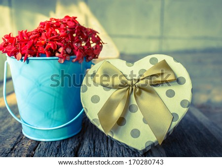Heart shaped Valentines Day gift box with flower - stock photo