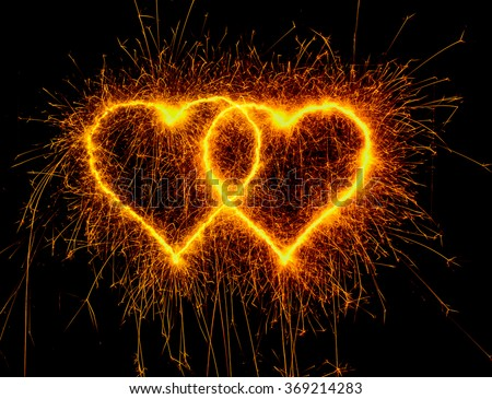 heart sparkle, Valentines day. duo heart gold color. Sparklers heart,  Heart of sparklers on black background,love and light. - stock photo
