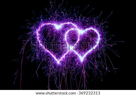 heart sparkle, Valentines day heart purple color. Sparklers heart,  Heart of sparklers on black background,love and light. - stock photo
