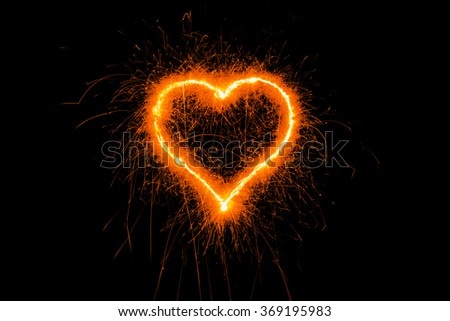 heart sparkle, Valentines Day Heart. Sparklers heart,  Heart of sparklers on black background,love and light. - stock photo