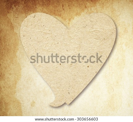 Heart speech bubble  with shadow on brown vintage paper - stock photo